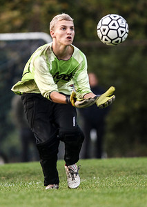 Sarah Nader- snader@shawmedia.com Jacobs' goalie Spencer Dixon stops a goal during the second half of Tuesday's FVC Valley match against Dundee-Crown in Carpentersville October 15, 2013. Dundee-Crown defeated Jacobs, 5-0 and finished their regular season 19-0-1.
