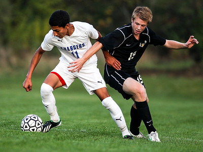 Sarah Nader- snader@shawmedia.com Dundee-Crown's Juan Ramos (left) is defended by Jacobs' Ean Wilson during the first half of Tuesday's FVC Valley match in Carpentersville October 15, 2013. Dundee-Crown defeated Jacobs, 5-0 and finished their regular season 19-0-1.