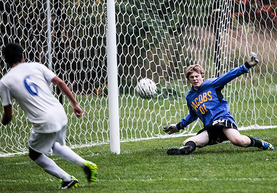 Sarah Nader- snader@shawmedia.com Jacobs's Aaron Camp stops a goal during the second half of Tuesday's FVC Valley match against Dundee-Crown in Carpentersville October 15, 2013. Dundee-Crown defeated Jacobs, 5-0 and finished their regular season 19-0-1.