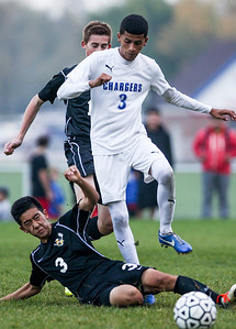 Sarah Nader- snader@shawmedia.com Jacobs' Daniel Kim (left) tries to steal the ball from Dundee-Crown's Francisco Nava during the second half of Tuesday's FVC Valley match in Carpentersville October 15, 2013. Dundee-Crown defeated Jacobs, 5-0 and finished their regular season 19-0-1.