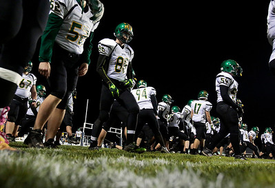 Kyle Grillot - kgrillot@shawmedia.com   Crystal Lake South team warms up before the second half of the high school football game at Cary-Grove High School Friday October 18, 2013. Cary-Grove won the game 21-14.