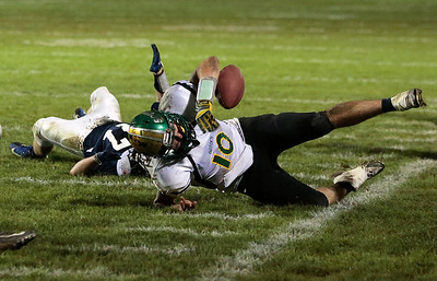 Kyle Grillot - kgrillot@shawmedia.com   Crystal Lake South senior Austin Rogers bobbles the ball out of bounds during the during the high school football game at Cary-Grove High School Friday October 18, 2013. Cary-Grove won the game 21-14.