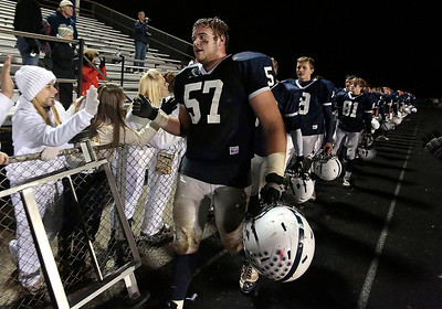Kyle Grillot - kgrillot@shawmedia.com   Cary-Grove Junior Trevor Ruhland leads his team in greeting fans after the high school football game against Crystal Lake South Friday October 18, 2013. Cary-Grove won the game 21-14.