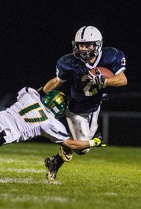 Kyle Grillot - kgrillot@shawmedia.com   Cary-Grove junior Matt Sutherland escapes Crystal Lake South senior Casey Oliver's tackle during the third quarter of the high school football game at Cary-Grove High School Friday October 18, 2013. Cary-Grove won the game 21-14.
