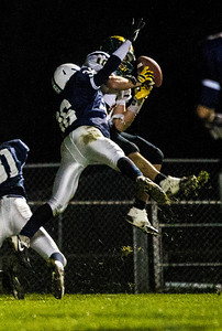 Kyle Grillot - kgrillot@shawmedia.com   Crystal Lake South senior Austin Rogers (10) catches a pass for a touchdown under the defense of Cary-Grove senior Matt Hughes (38) during the second quarter of the high school football game at Cary-Grove High School Friday October 18, 2013. Cary-Grove won the game 21-14.