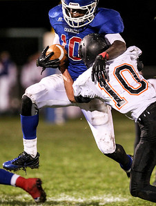 Sarah Nader- snader@shawmedia.com Dundee-Crown's Malik Dunner (left) is tackled by McHenry's Kyle Postal during the second quarter of Friday's game against McHenry in Carpentersville October 18, 2013. Dundee-Crown defeated McHenry, 49-21.