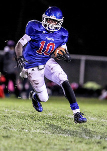 Sarah Nader- snader@shawmedia.com Dundee-Crown's Malik Dunner runs 53 yard for a touchdown during the second quarter of Friday's game against McHenry in Carpentersville October 18, 2013. Dundee-Crown defeated McHenry, 49-21.