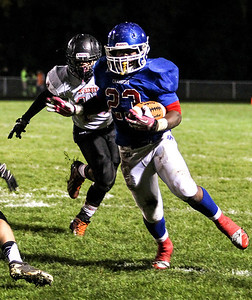 Sarah Nader- snader@shawmedia.com Dundee-Crown's Cordero Parson runs a play during the third quarter of Friday's game against McHenry in Carpentersville October 18, 2013. Dundee-Crown defeated McHenry, 49-21.