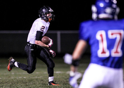 Sarah Nader- snader@shawmedia.com McHenry's Payton Lykins runs a play during the first quarter of Friday's game against Dundee-Crown in Carpentersville October 18, 2013. Dundee-Crown defeated McHenry, 49-21.