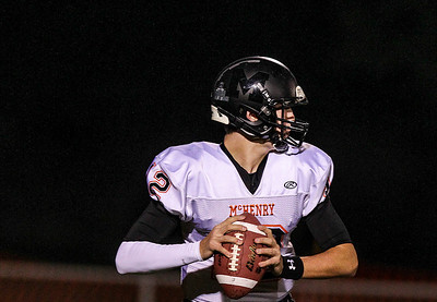 Sarah Nader- snader@shawmedia.com McHenry's quarterback Mike Briscoe throws a pass during the second quarter of Friday's game against Dundee-Crown in Carpentersville October 18, 2013. Dundee-Crown defeated McHenry, 49-21.
