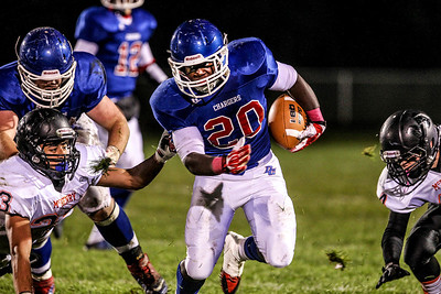 Sarah Nader- snader@shawmedia.com Dundee-Crown's Caleb Parson runs a play during the third quarter of Friday's game against McHenry in Carpentersville October 18, 2013. Dundee-Crown defeated McHenry, 49-21.
