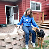 Rover Rescue foster home coordinator Teri Grandt in the backyard of her North Aurora home with of her foster dogs, Dharma and Hope.