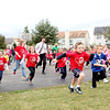 Heartland Elementary School students, along with Principal Adam Law (center), take off for the Kids' Dash as part of the Geneva school's annual Run for Heart fundraiser. This year's event raised $2,800 for the Northern Illinois Food Bank.