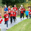 Heartland Elementary School students participate in a one-mile run as part of the Geneva school's annual Run for Heart fundraiser. This year's event raised $2,800 for the Northern Illinois Food Bank.