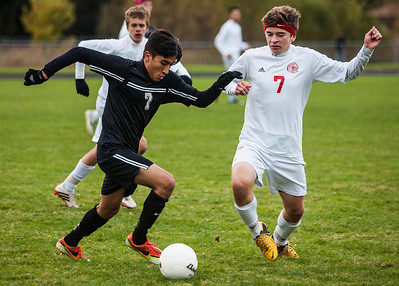 Kyle Grillot - kgrillot@shawmedia.com   Marian Central junior Robert Anderson (right) and Prairie Ridge sophomore Adolfo Baca fight for control of the ball during the second half of the in Class 2A regional semifinal match at Marian Central High School Tuesday, October 22, 2013. Marian Central won the match 3-1.