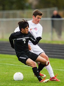 Kyle Grillot - kgrillot@shawmedia.com   Marian Central sophomore Gavin Sell (right) and Prairie Ridge sophomore Adolfo Baca fight for control of the ball during the second half of the in Class 2A regional semifinal match at Marian Central High School Tuesday, October 22, 2013. Marian Central won the match 3-1.