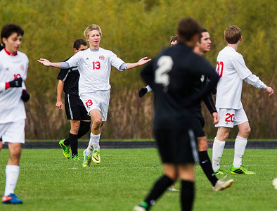Kyle Grillot - kgrillot@shawmedia.com   Marian Central junior Liam Gries (13) celebrates after scoring a goal in the first half of the in Class 2A regional semifinal match at Marian Central High School Tuesday, October 22, 2013. Marian Central won the match 3-1.