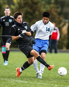 Sarah Nader- snader@shawmedia.com Woodstock North's Luis Balleno (left) steals the ball from  Woodstock's Sergio Garcia during the first half of Wednesday's Class 2A Marian Regional semifinal in Woodstock October 23, 2013. Woodstock North won, 5-0.