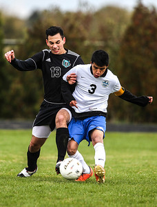Sarah Nader- snader@shawmedia.com Woodstock North's Riley Basaran (left) and Woodstock's Enrique Leyva fight for control of the ball during the first half of Wednesday's Class 2A Marian Regional semifinal in Woodstock October 23, 2013. Woodstock North won, 5-0.