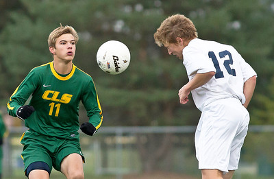 Brett Moist/ for the Northwest Herald  Cary Grove's Matt Scott hits the ball with his head past Crystal Lake South's Stefan Harris during the 1st half of their Regional Semi final match at Crystal Lake South on Wednesday. Crystal Lake South defeated Cary Grove 3-2 in Overtime.