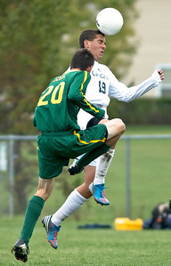 Brett Moist/ for the Northwest Herald  Cary Grove's Joey Klawitter hits the ball with his head past Crystal Lake South's Andrew Perrine during the 1st half of their Regional Semi final match at Crystal Lake South on Wednesday. Crystal Lake South defeated Cary Grove 3-2 in Overtime.