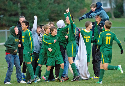 Brett Moist/ for the Northwest Herald  Crystal Lake South's fans and players celebrate their regional semi final win over Cary Grove at Crystal Lake South High School on Friday. Crystal Lake South defeated Cary Grove 3-2 in Overtime