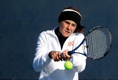 Kyle Grillot - kgrillot@shawmedia.com   Crystal Lake Central senior Evelyn Youel returns the ball during their match against Oak Park River Forest on the first day of the girls tennis state tournament Thursday, October 24, 2013.