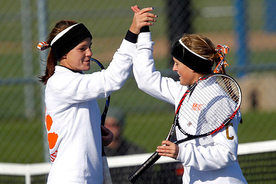 Kyle Grillot - kgrillot@shawmedia.com   Crystal Lake Central seniors Evelyn Youel (left) and Gillian Wallace celebrate a scored point during their match against Oak Park River Forest on the first day of the girls tennis state tournament Thursday, October 24, 2013.