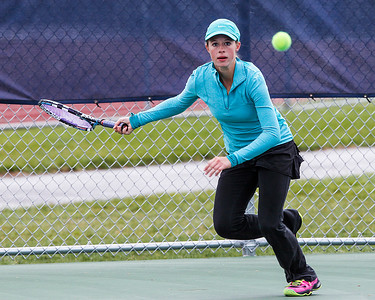 Kyle Grillot - kgrillot@shawmedia.com   Kaneland junior Madison Jercenko returns the ball during their match against Glenbrook South on the first day of the girls tennis state tournament Thursday, October 24, 2013.