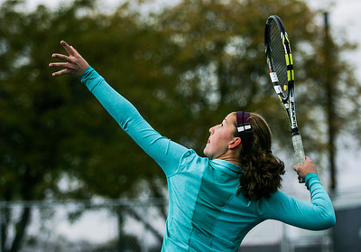 Kyle Grillot - kgrillot@shawmedia.com   Kaneland junior Angelica Emmanouil returns the ball during their match against Glenbrook South on the first day of the girls tennis state tournament Thursday, October 24, 2013.