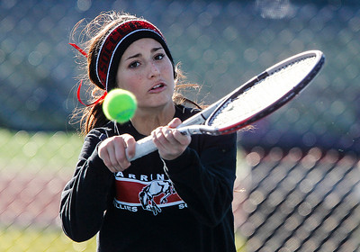 Kyle Grillot - kgrillot@shawmedia.com   Barrington junior Addie Hirsch returns the ball during the match against Alleman juniors Sarah Van Hoe and Lauren Hogan during the first day of the girls tennis state tournament Thursday, October 24, 2013.