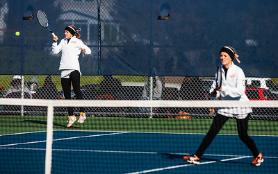 Kyle Grillot - kgrillot@shawmedia.com   Crystal Lake Central senior Evelyn Youel (left) returns the ball during their match against Oak Park River Forest on the first day of the girls tennis state tournament Thursday, October 24, 2013.