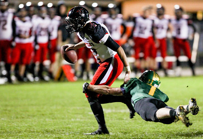 Sarah Nader- snader@shawmedia.com Huntley's quarterback Blake Jacobs (left) is tackled by Crystal Lake South's Chris Ivers during the first quarter of Friday's football game in Crystal Lake October 25, 2013. Crystal Lake South defeated Huntley, 27-7.