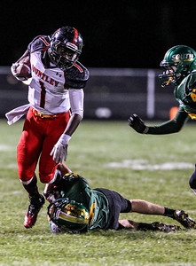 Sarah Nader- snader@shawmedia.com Huntley's Josh Esikiel (left) is tackled by Crystal Lake South's Joey Ahsmann during the second quarter of Friday's football game in Crystal Lake October 25, 2013. Crystal Lake South defeated Huntley, 27-7.