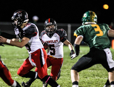 Sarah Nader- snader@shawmedia.com Huntley's Jake Scalise runs a play during the first quarter of Friday's football game against Crystal Lake South in Crystal Lake October 25, 2013. Crystal Lake South defeated Huntley, 27-7.