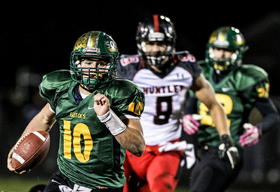 Sarah Nader- snader@shawmedia.com Crystal Lake South's quarterback Austin Rogers scores a touchdown during the second quarter of Friday's football game against Huntley in Crystal Lake October 25, 2013. Crystal Lake South defeated Huntley, 27-7.
