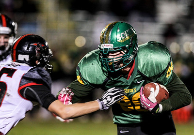 Sarah Nader- snader@shawmedia.com Crystal Lake South's Wes Buckner runs a play during the first quarter of Friday's football game against Huntley in Crystal Lake October 25, 2013. Crystal Lake South defeated Huntley, 27-7.27-7.