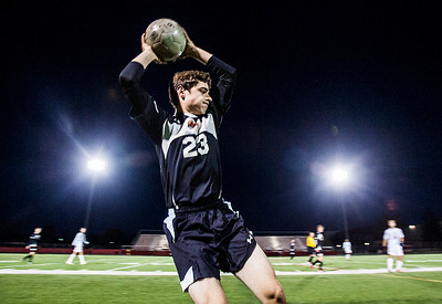 Kyle Grillot - kgrillot@shawmedia.com   Libertyville junior Ryan Pacholski throws the ball in during the first half of the boys regional final match between Barrington and Libertyville Saturday, October 26, 2013. Barrington won the match 2-0.