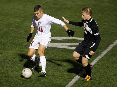 Kyle Grillot - kgrillot@shawmedia.com   Barrington junior Shawn Owen (11) controls the ball under the defense of Libertyville senior Lloyd Chatfield during the second half of the boys regional final match between Barrington and Libertyville Saturday, October 26, 2013. Barrington won the match 2-0.