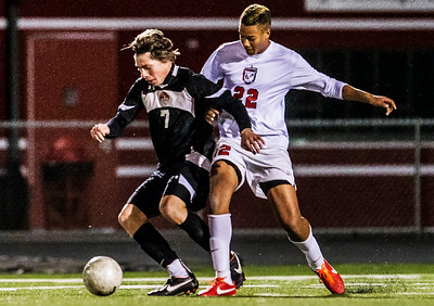 Kyle Grillot - kgrillot@shawmedia.com   Libertyville senior Nick Vogel (7) controls the ball under the defense of Barrington junior Giles Phillips (22)during the first half of the boys regional final match between Barrington and Libertyville Saturday, October 26, 2013. Barrington won the match 2-0.