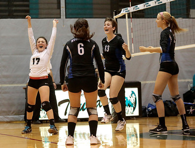 Kyle Grillot - kgrillot@shawmedia.com  The Woodstock team celebrates after the final point of the third game of the regional quarterfinal match between Woodstock North and Woodstock. Woodstock won the match.