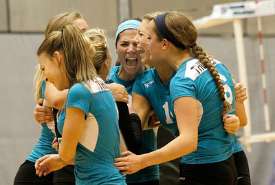 Kyle Grillot - kgrillot@shawmedia.com  The Woodstock North team celebrates a scored point during the first game of the regional quarterfinal match between Woodstock North and Woodstock. Woodstock won the match.