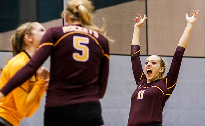 Kyle Grillot - kgrillot@shawmedia.com   Richmond-Burton junior Grace Schwegel celebrates a scored point with her team during the first game of the regional semifinal match between Richmond-Burton and Marian Central. Marian Central won the match in three games.