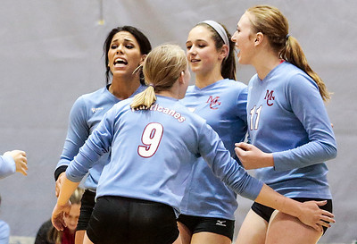 Kyle Grillot - kgrillot@shawmedia.com   The Marian Central team comes together after a scored point during the first game of the regional semifinal match between Richmond-Burton and Marian Central. Marian Central won the match in three games.