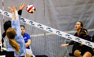 Kyle Grillot - kgrillot@shawmedia.com   Richmond-Burton junior Kayla Volling spikes the ball towards the Marian Central defense during the first game of the regional semifinal match between Richmond-Burton and Marian Central. Marian Central won the match in three games.