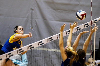 Kyle Grillot - kgrillot@shawmedia.com   Johnsburg senior Amy Majercik spikes the ball past the Woodstock defense during the second game of the regional semifinal match between Johnsburg and Woodstock. Johnsburg won the match in two games.