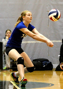 Kyle Grillot - kgrillot@shawmedia.com   A Woodstock player whose number is not on the roster bumps the ball during the second game of the regional semifinal match between Johnsburg and Woodstock. Johnsburg won the match in two games.