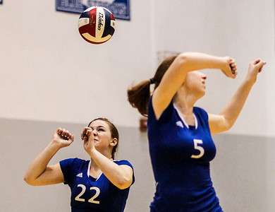 Kyle Grillot - kgrillot@shawmedia.com   Woodstock sophomore Brecken Overly (22) and senior Andrea Wright can't get control of the ball during the first game of the regional semifinal match between Johnsburg and Woodstock. Johnsburg won the match in two games.