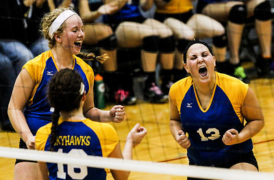 Kyle Grillot - kgrillot@shawmedia.com   Johnsburg senior Emily Whitlock (13) celebrates with her teammates after a scored point during the second game of the regional semifinal match between Johnsburg and Woodstock. Johnsburg won the match in two games.