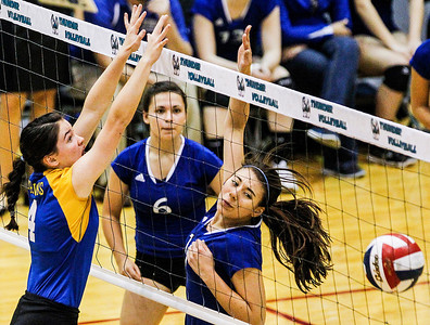 Kyle Grillot - kgrillot@shawmedia.com   Woodstock junior Selena Juarez (right) watches as her ball is blocked by Johnsburg senior Amanda Cherwin (left) during the second game of the regional semifinal match between Johnsburg and Woodstock. Johnsburg won the match in two games.